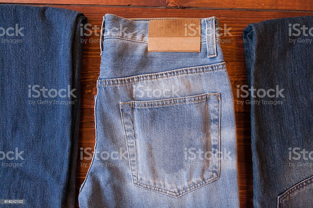 Jeans on wooden background. stock photo