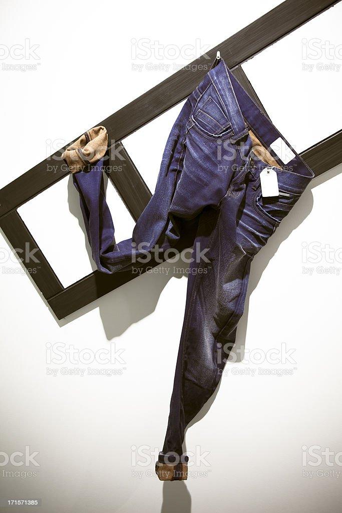 Jeans Pants Hanging at Retail Display royalty-free stock photo