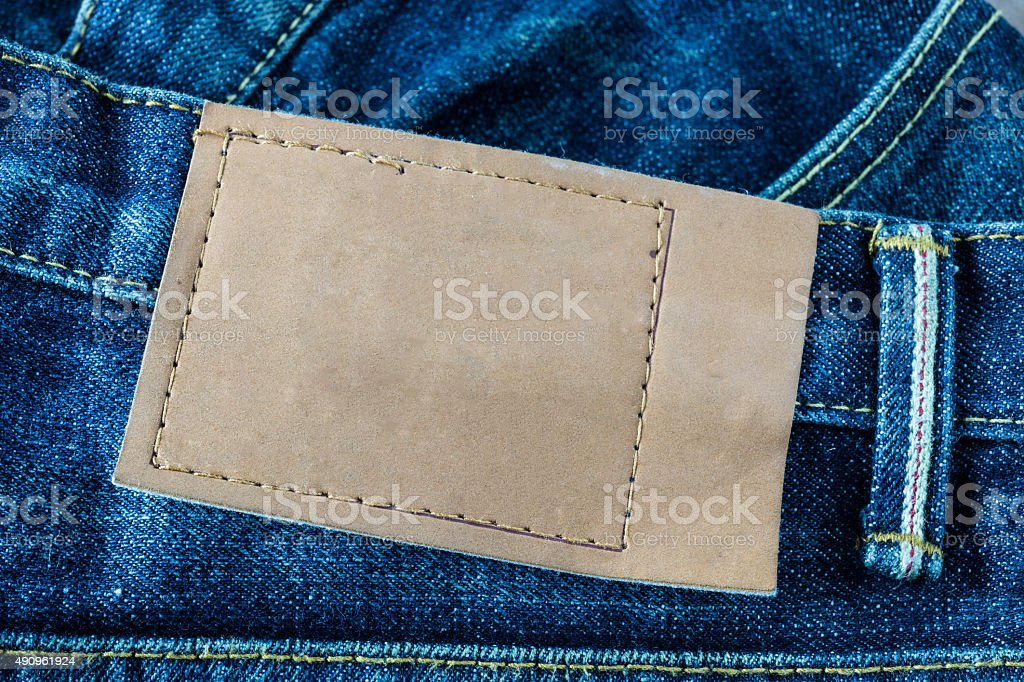 jeans pants with back pocket and brown leather tag stock photo