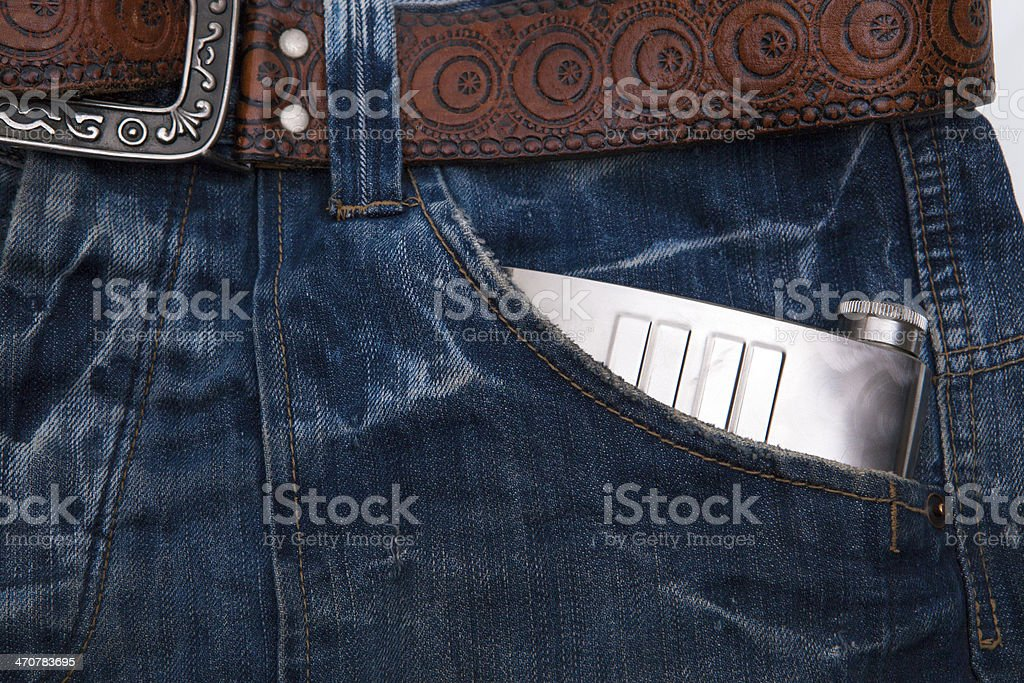 Jeans pocket flask royalty-free stock photo