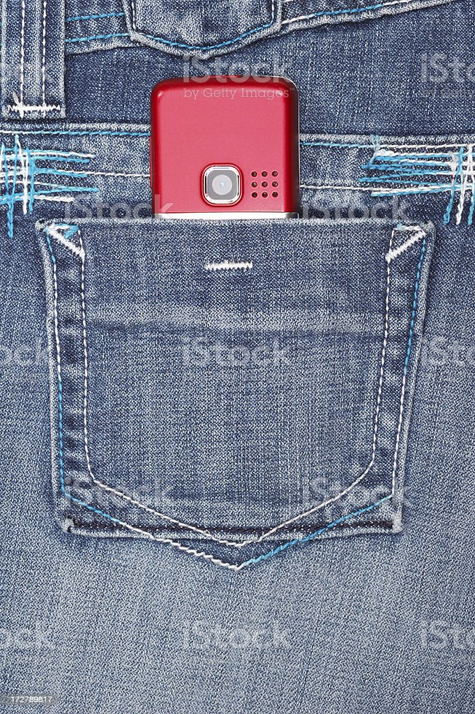 Jeans pocket with cellular phone stock photo
