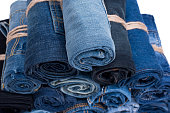 Jeans roll stack on the isolated background