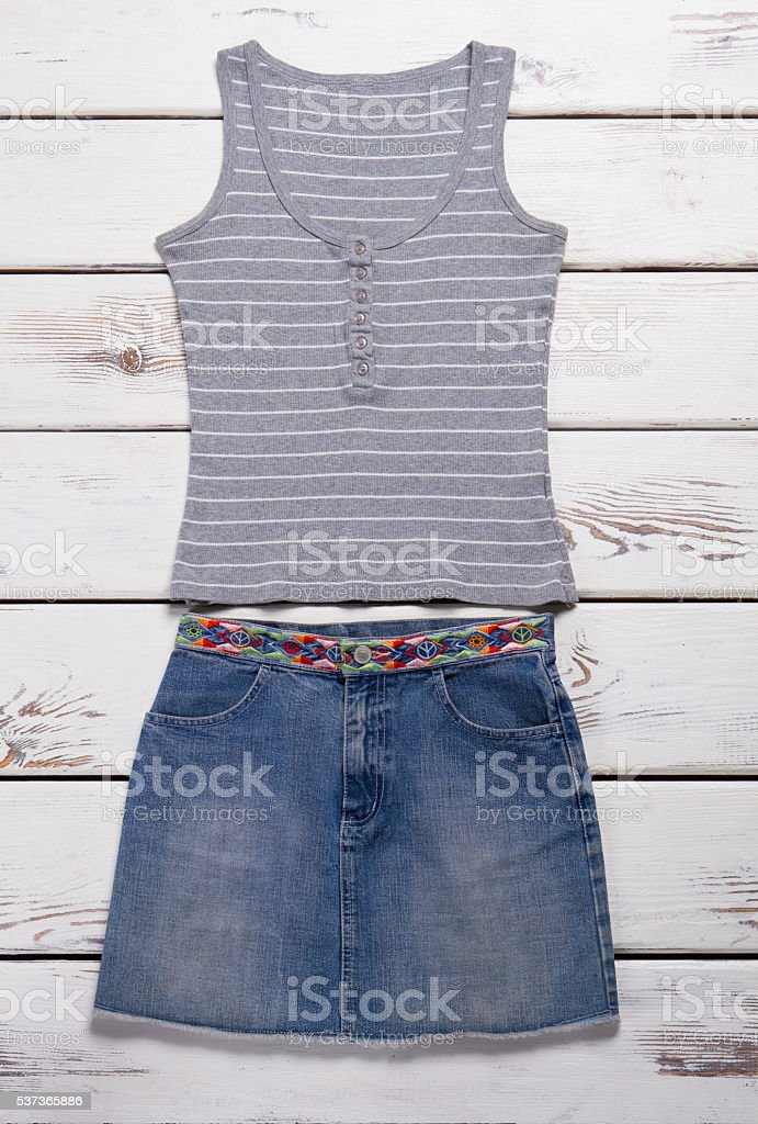 Jeans skirt and tank top. stock photo