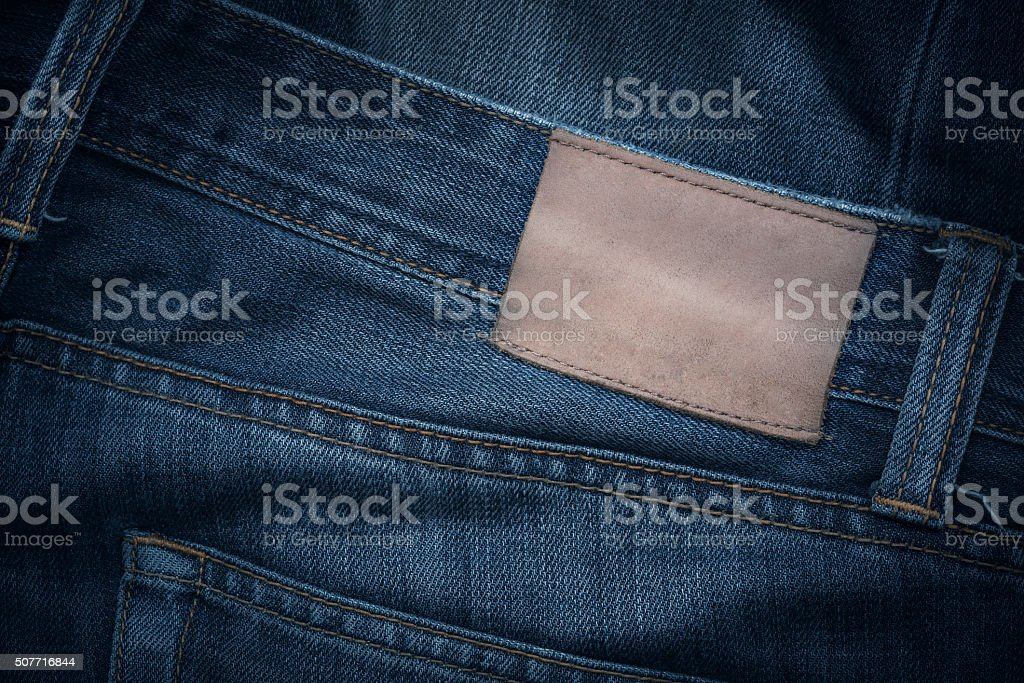 Jeans texture with empty leather label stock photo