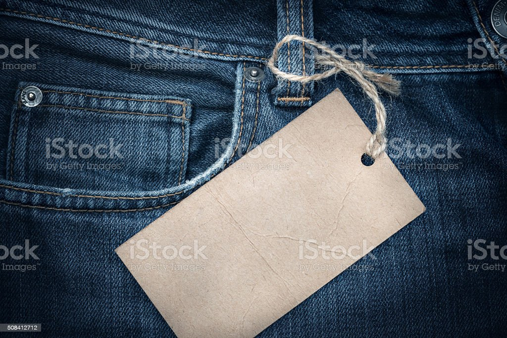 Jeans texture with empty paper label stock photo