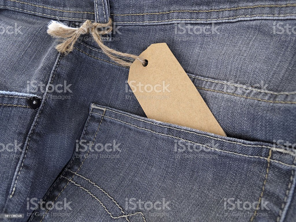 jeans with empty price tag royalty-free stock photo