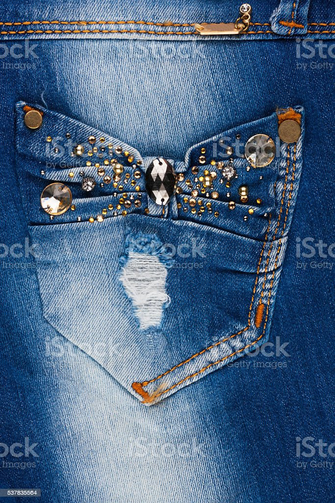 Jeans with pockets close-up decorated with rhinestones stock photo