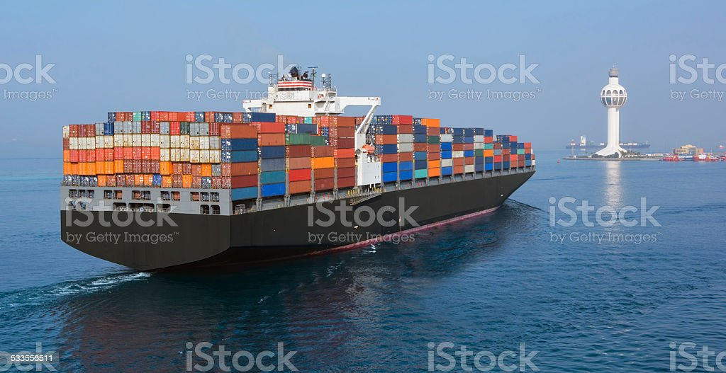 Jeddah Port Control Tower and container ship stock photo