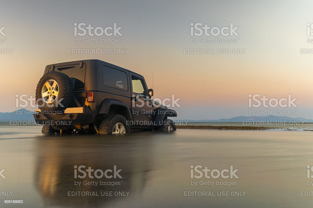 Jeep 4x4 got stuck in the mud. stock photo