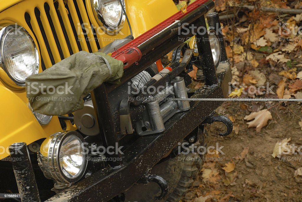 Jeep being pulled by wench royalty-free stock photo