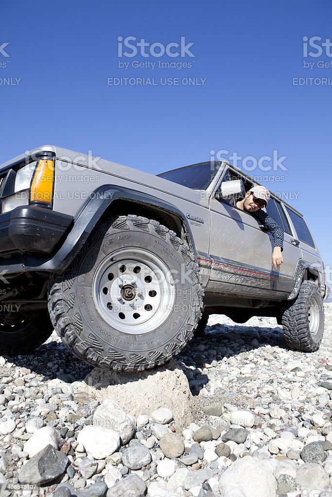 Jeep Cherokee sport over crest. royalty-free stock photo