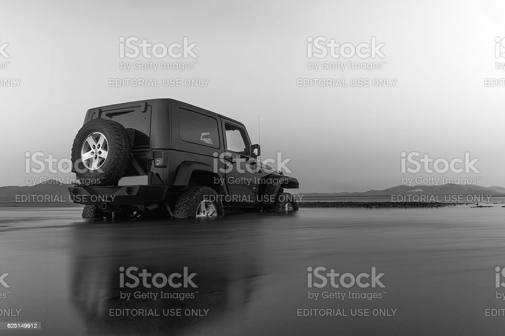 Jeep got stuck in the mud at a wetland. stock photo
