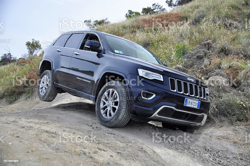 Jeep Grand Cherokee on the unmade road stock photo