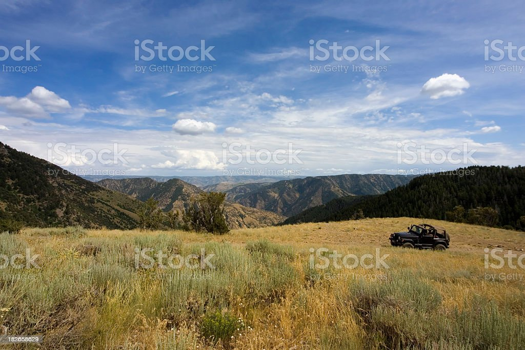 Jeep in Scenic Landscape stock photo