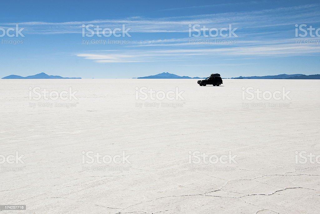 Jeep in the salt desert Uyuni, Bolivia. stock photo