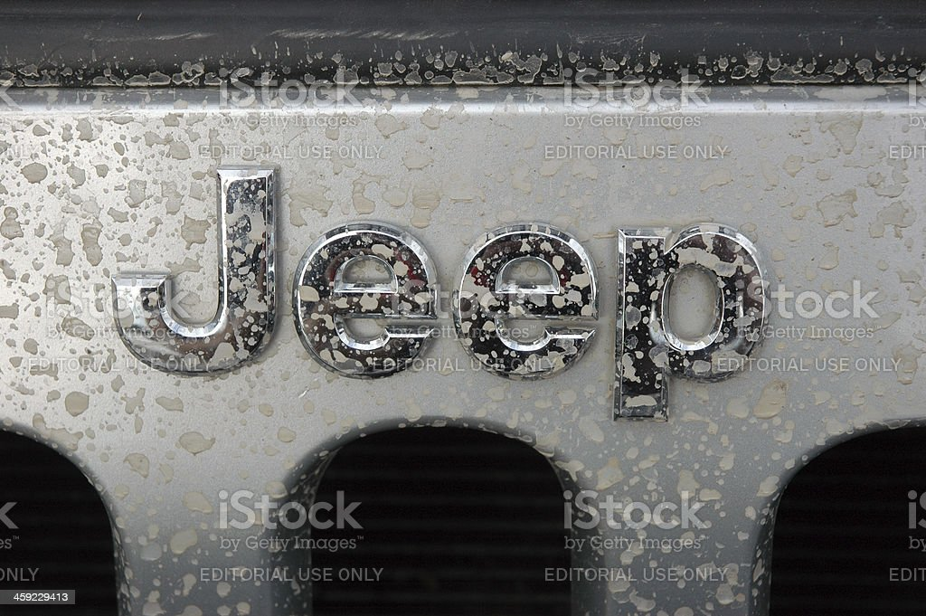 Jeep name badge logo on a silver wrangler splash marks stock photo
