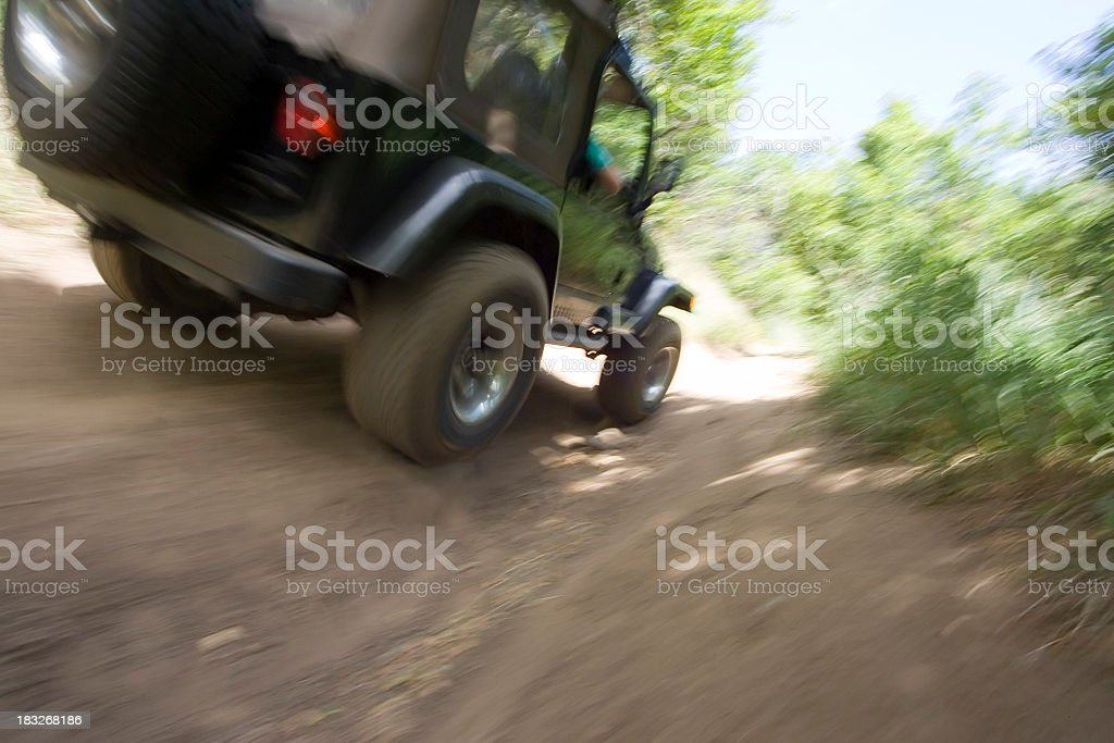 Jeep on Trail with Motion Blur stock photo