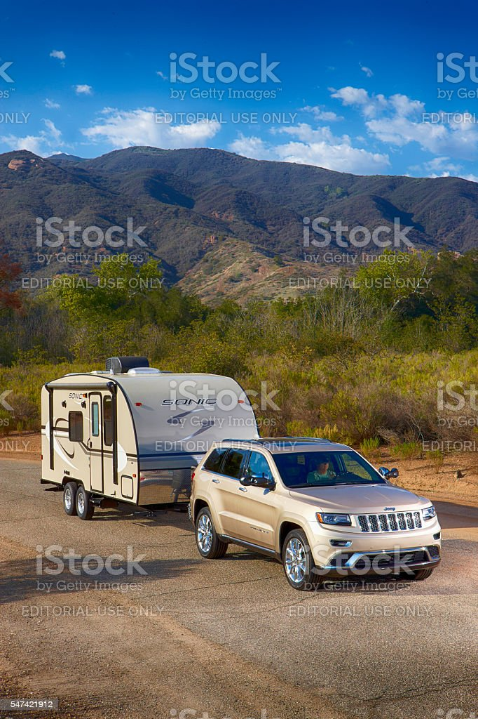 Jeep pulling a  sonic camper stock photo