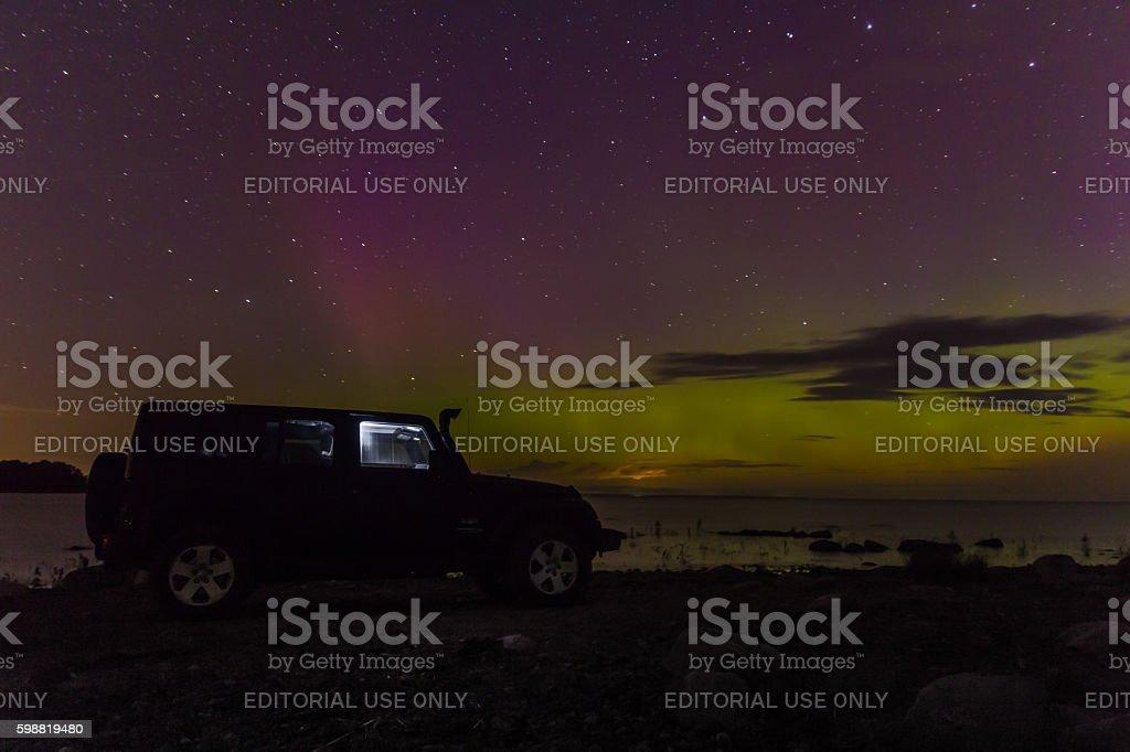 Jeep Wrangler on the shore of Lake Ladoga stock photo