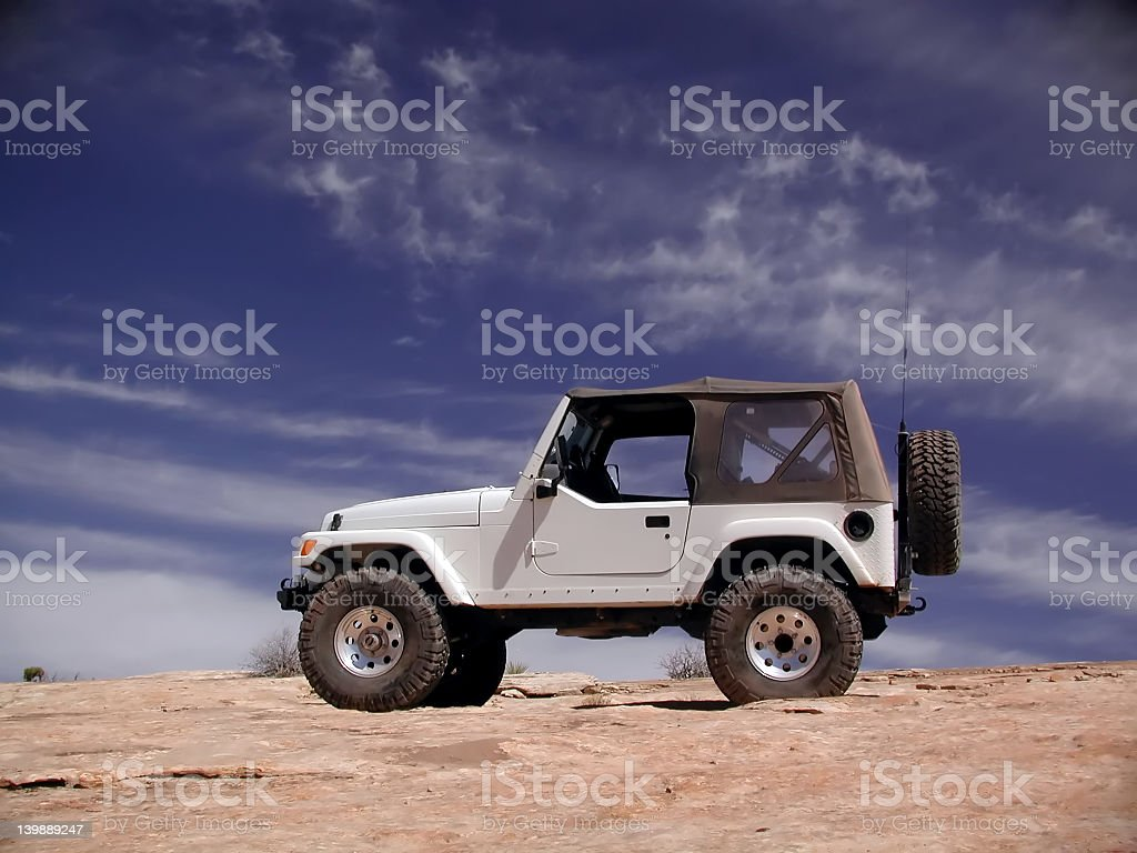 Jeep Wrangler on top of a sand dune stock photo