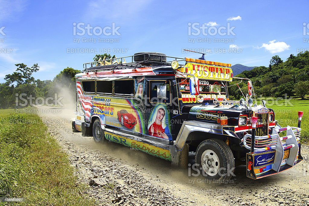 Jeepney on a rural road. stock photo