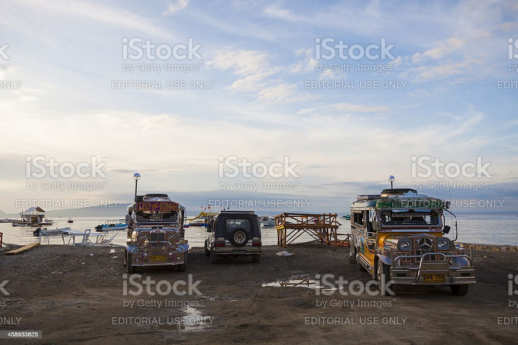 Jeepneys are parked by the waterfront at Sabang, Philippines stock photo