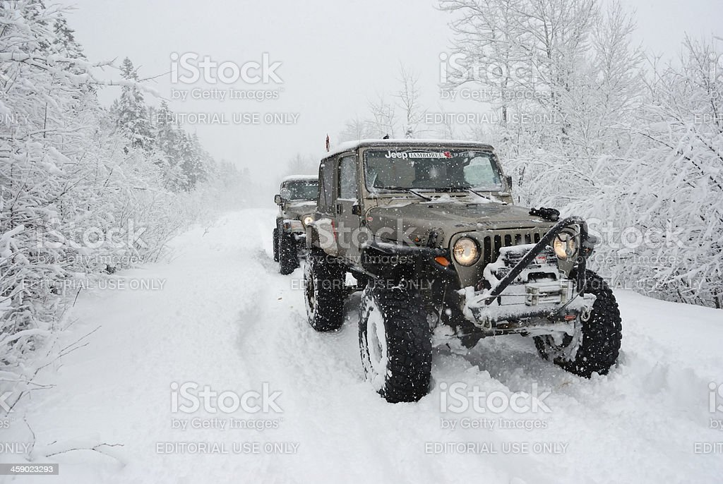 Jeeps Off-Roading in the Snow royalty-free stock photo