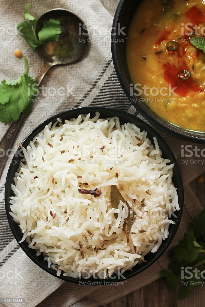 Jeera Rice served with lentil curry top down view stock photo