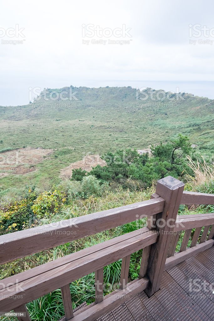 Jeju coast view with cloudy sky from Seongsan ilchubaong mountai stock photo