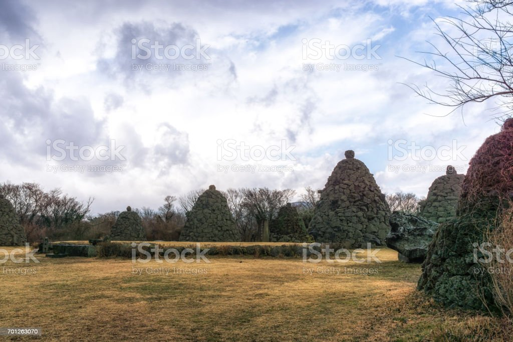 jeju stone park tall stone towers stock photo