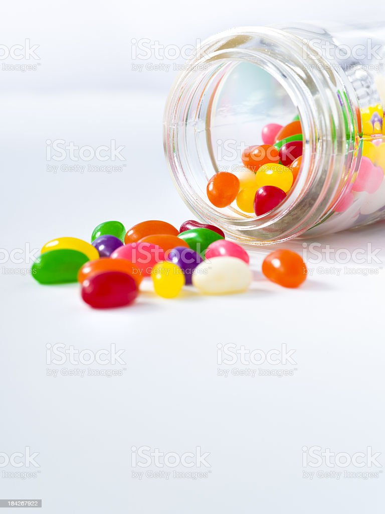 Jelly beans spill out of a jar royalty-free stock photo
