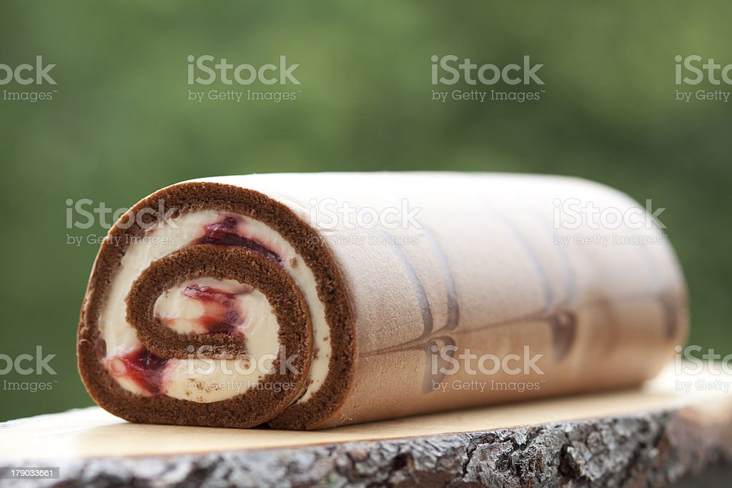 Jelly roll with cream and cherries stock photo