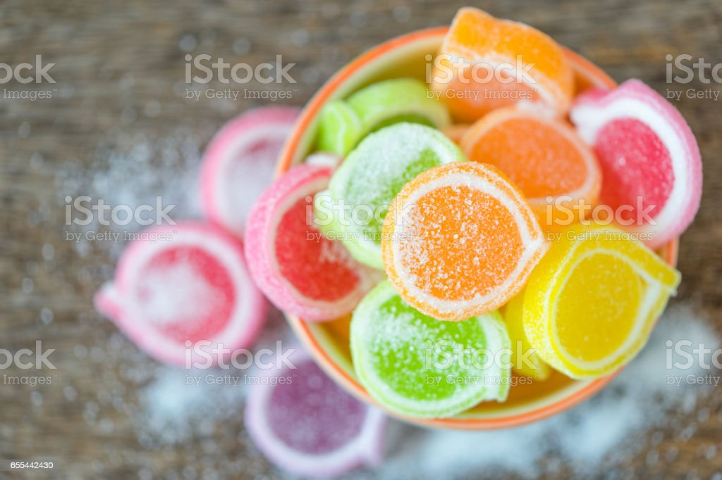 Jelly sweet, flavor fruit, candy dessert colorful in ceramic bowl on wood background. stock photo