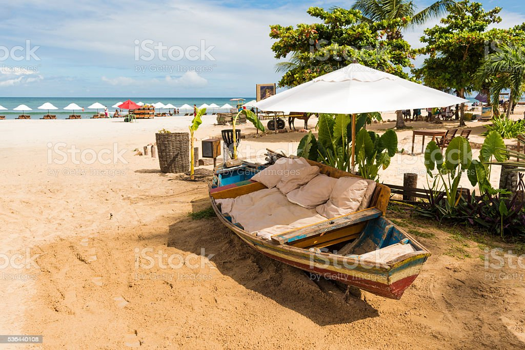 Jericoacoara beach, traditional boat used as a relaxing chair. stock photo