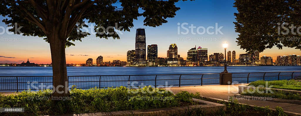 Jersey City Waterfront with Hudson River from Manhattan at Sunset stock photo