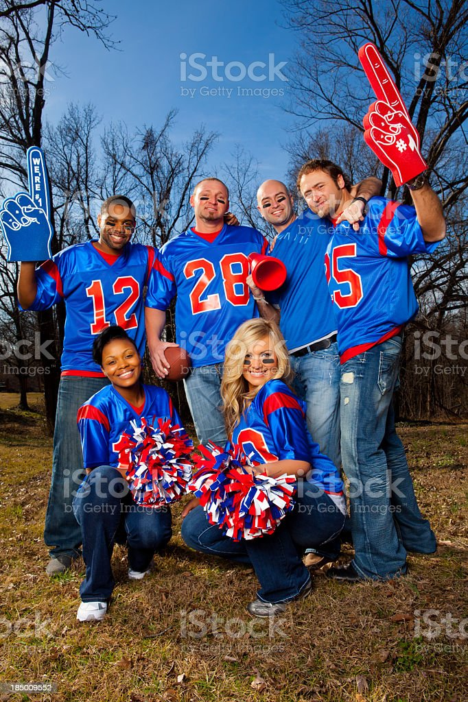 Jersey wearing football fans posing for a photo stock photo
