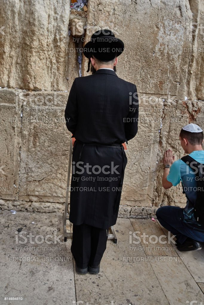 Jerusalem - 15 November, 2016: Men praying at the 'wailing wall', Jerusalem old city stock photo