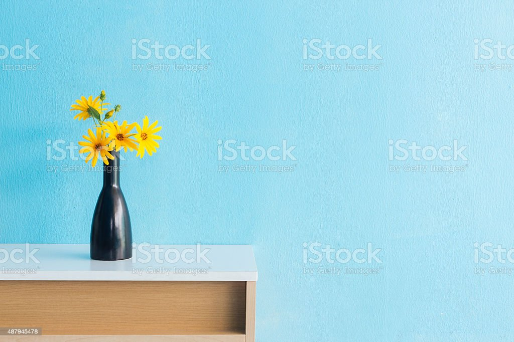 Jerusalem artichoke flower in vase on table interior design stock photo