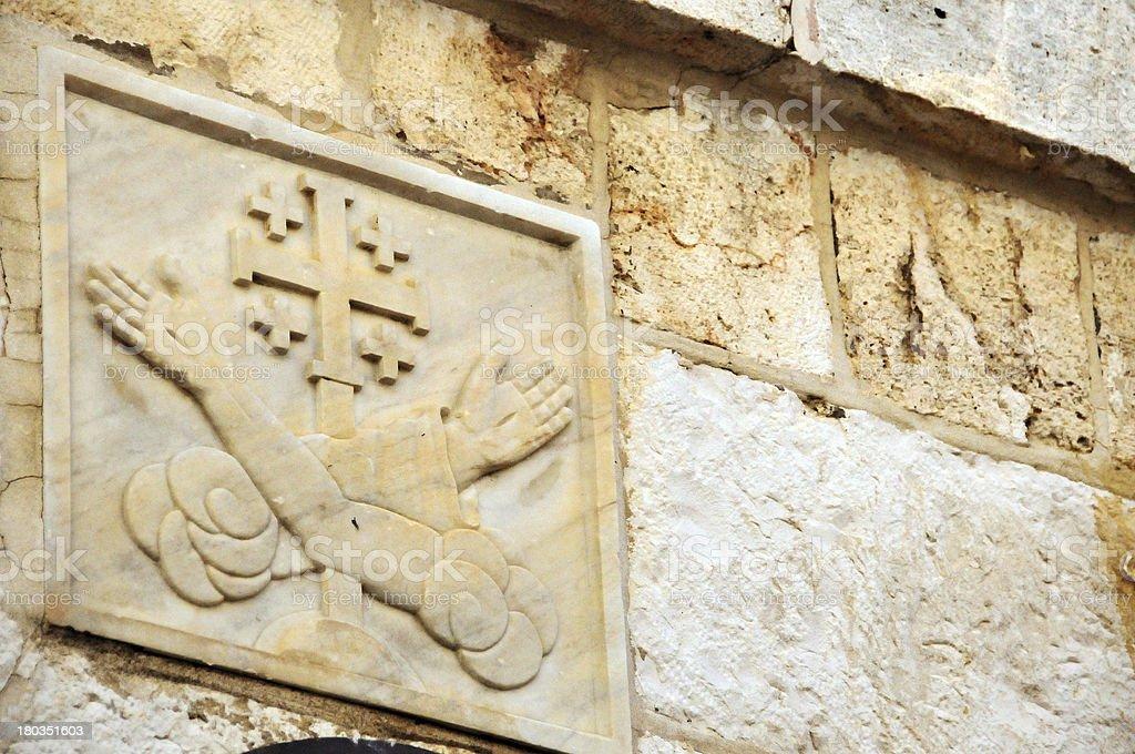 Jerusalem, Israel: Via Dolorosa, Station 5, carving of Franciscan arms stock photo