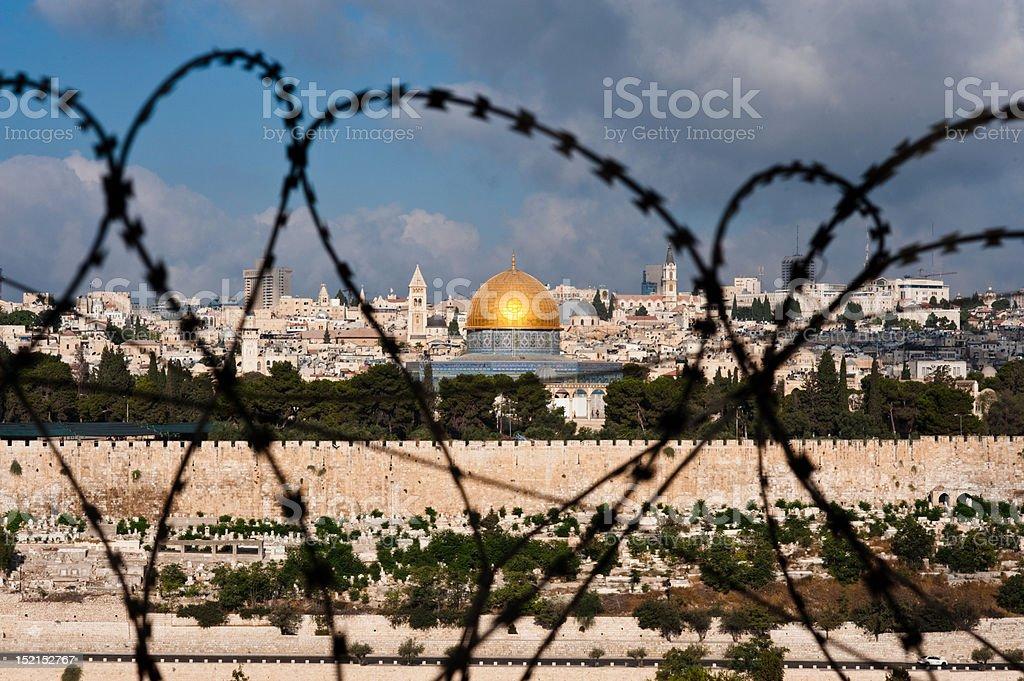 Jerusalem Through Razor Wire stock photo