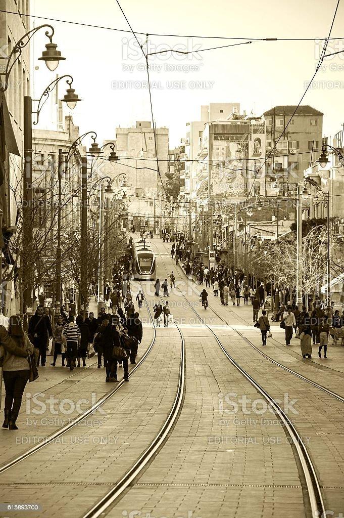 Jerusalem Tram train and the pedestrians on Jaffa Road street. stock photo