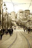 Jerusalem Tram train and the pedestrians on Jaffa Road street.