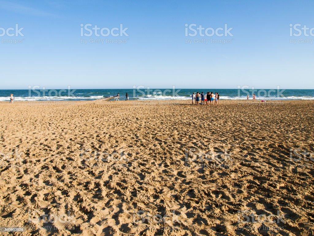 Jesolo beach with tourist stock photo