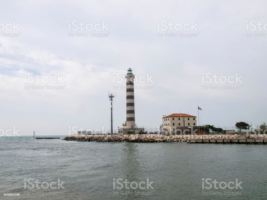 Jesolo lightouse for access to the port stock photo