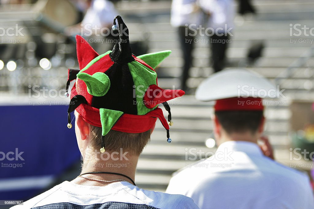 Jester and policeman. royalty-free stock photo