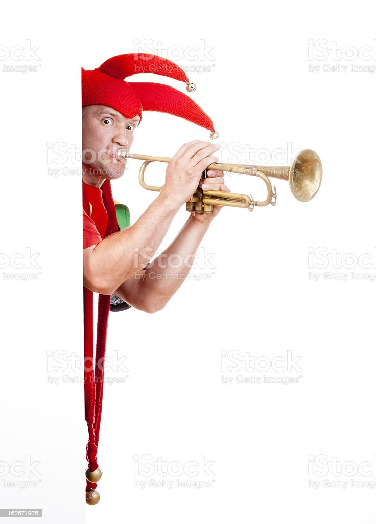 jester blowing trumpet stock photo