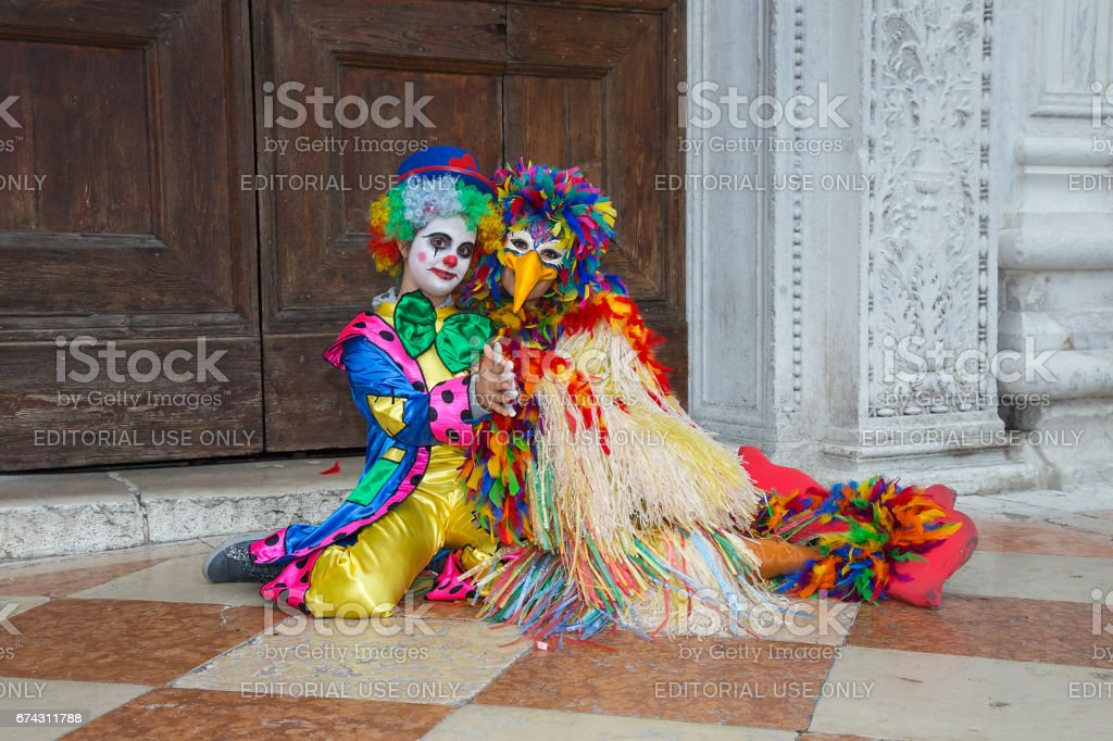 Jester mask on Venice Carnival - Clown Mask in colorful costume on St. Mark's Square in Venice stock photo