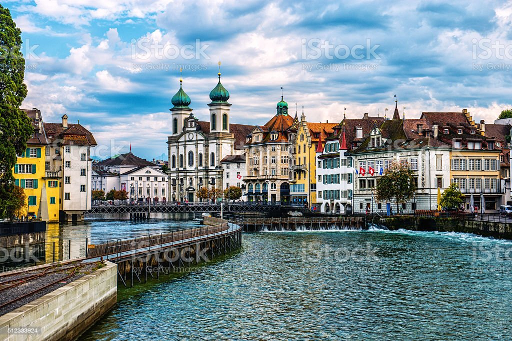 Jesuit Church and Reuss River in old town Lucerne, Switzerland stock photo