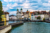 Jesuit Church and Reuss River in old town Lucerne, Switzerland