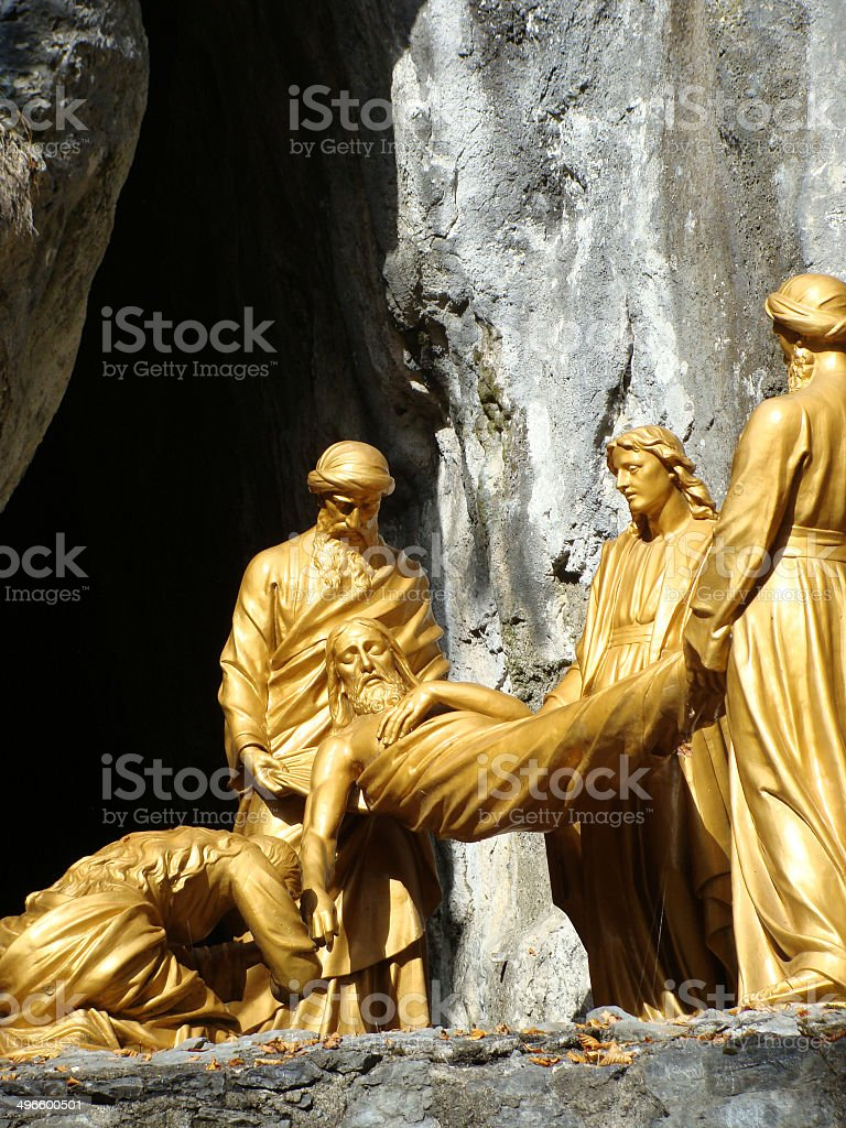 Jesus at tomb statue close up, Lourdes, France royalty-free stock photo